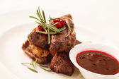 Meat with sauce — Stock Photo