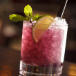 Stock Photo: Cocktail with blackberries and straw