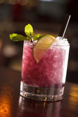 Cocktail with blackberries and straw — Stock Photo