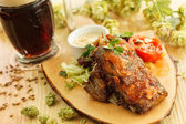Grilled meat with beer — Stock Photo