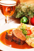 Roasted meat on Christmas table — Stock Photo
