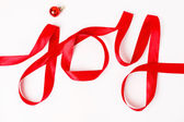 Joy word written in red ribbon — Stock fotografie