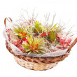 Flowers and grass in basket — Stock Photo