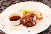 Steak with sauce — Stock Photo