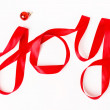 Joy word written in red ribbon — Stok fotoğraf