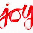 Joy word written in red ribbon — Stockfoto