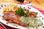Grilled steak with french fries — Stock Photo