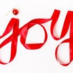 Joy word written in red ribbon — Stock Photo #36603687