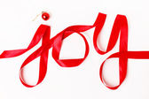Joy word written in red ribbon — Стоковое фото