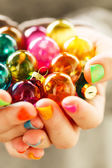 Christmas balls in the hands — Stock Photo