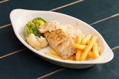 Chicken breast with french fries — Stock Photo