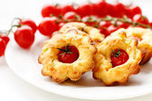 Cakes with cherry tomatoes — Stock Photo