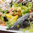 Stuffed fish with salad — Stock Photo