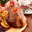 Roasted duck on Christmas table — Stock Photo #37332251