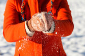Woman hand in snowed gloves — Stock Photo