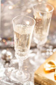 Champagne glasses on celebration table — Stock Photo