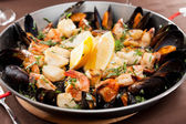 Seafood paella in the fry pan — Stock Photo