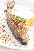Trout fish baked with nuts — Stock Photo