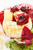 Camembert with cherry sauce — Stock Photo
