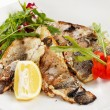 Grilled fish fillet with tomato and lemon — Stock Photo