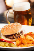 Burger with beer — Stock Photo