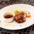 Steak with sauce — Stock Photo