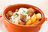 Potatoes with meat in the pot — Stock Photo