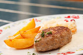 Cutlet with potatoes — Stock Photo