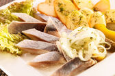 Herring slice with boiled potato — Stock Photo