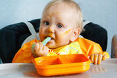 Eating baby boy with dirty face — Stock Photo