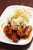 Grilled ribs with salad — Stock Photo