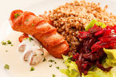 Buckwheat with sausage — Stock Photo