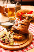 Eisbein with braised cabbage, salad and beer — Stock Photo