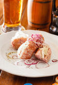 Pork sausages with onion — Stock Photo