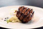Steak with mashed potatoes — Stock Photo