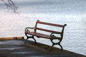 Empty bench near the lake — Stock Photo