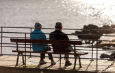 Senior couple on the bench near lake in park — Stock Photo