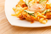 French fries with chicken — Stock Photo