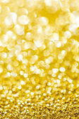 Abstract holidays golden lights on background — Stock Photo