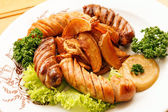 Sausages with potatoes — Stock Photo