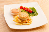 French fries with chicken cutlet — Stockfoto
