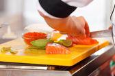 Chef making sushi — Stock Photo