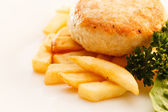 French fries with chicken cutlet — Stock Photo