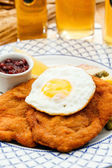 Wiener Schnitzel with egg — Stock Photo