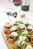 Tomato, mozzarella and arugula sandwich — Foto de Stock