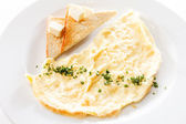 Omelette, vegetables and toasts with butter — Stock Photo