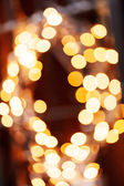 Golden christmas lights — Stock Photo