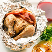 Roast quail in the foil — Stock Photo