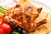 Roasted quail with vegetables — Stock Photo