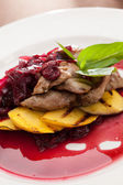 Meat with mango and cherry sauce — Stock Photo